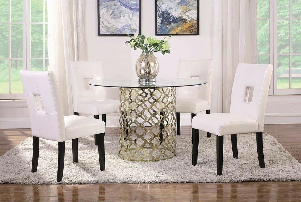 round glass gold dining table and white